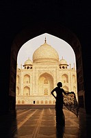 Silhouette of a woman standing in front of a mausoleum, Taj Mahal, Agra, Uttar Pradesh, India