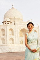 Portrait of a young woman standing in front of a mausoleum, Taj Mahal, Agra, Uttar Pradesh, India (thumbnail)