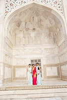 Portrait of three young women standing in a mausoleum, Taj Mahal, Agra, Uttar Pradesh, India