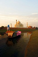 Rear view of a man rowing a boat, Taj Mahal, Agra, Uttar Pradesh, India
