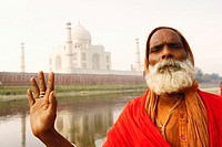 Portrait of a priest standing on the riverbank, Taj Mahal, Agra, Uttar Pradesh, India