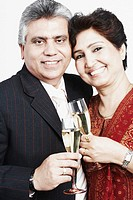 Portrait of a mature couple toasting with champagne flutes