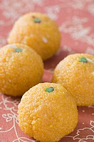 Close-up of four Ladoos (thumbnail)