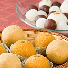Close-up of Ladoos in a basket (thumbnail)