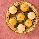 High angle view of Ladoos in a basket