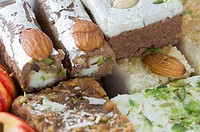 Close-up of sweets garnished with Almonds and Pistachio