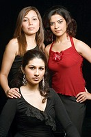 Portrait of three young women looking serious