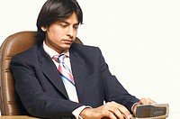 Close-up of a businessman using a mobile phone (thumbnail)