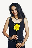 Portrait of a mid adult woman holding a sunflower