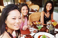 Three young women dining in a restaurant