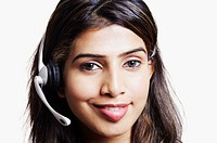 Portrait of a young woman wearing a headset and smiling