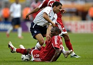 Sport, football, world championships, England versus Trinidad and Tobago, 2:0, Nuremberg, 15 6 2006, from left to right, Aaron Lennon, Cyd Gray, sport...