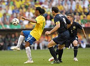 Sport, football, world championships, Brazil versus Australia, 2:0, Munich, 18 6 2006, from left to right, Ronaldinho, Mark Viduka, Jason Culina, foot...