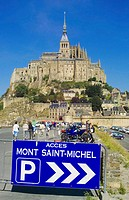 Car park sign and Mont St. Michel. Normandy, France