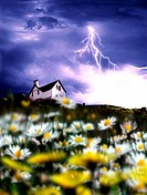 Lightening above house in field of flowers
