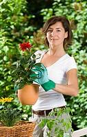 Portrait of mid adult woman gardening