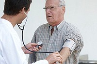 Close-up of a male doctor checking a senior man's blood pressure