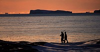 Inuit hunters coming back home after a day of hunting in the Inuit village of Rodebay, Disko Bugt on western Greenland