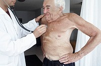 Male doctor examining a senior man with a stethoscope