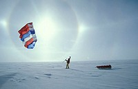 Modern polar traveler at the Antarctic ice cap, at only 20 miles from the geographic South Pole, 90 degrees North, near the American Amundsen-Scott So...