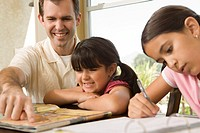 Father helping children with homework (thumbnail)
