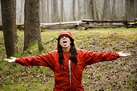 Female hiker makes the best of an April shower in Great Smoky Mountains National Park, Tennessee, USA.