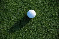 Close view of a golf ball on the green