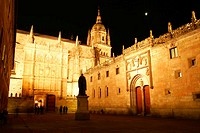 Night view of the main facade of the University of Salamanca and cathedral tower, Salamanca. Castilla-León, Spain