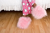 Girl wearing fluffy slippers (thumbnail)