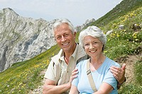 Senior couple on mountainside