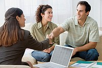 Couple talking to a financial advisor