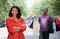 Man holding bags for woman