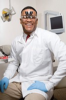 Dentist wearing dental binocular loupes (thumbnail)