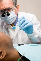 Man having teeth examined