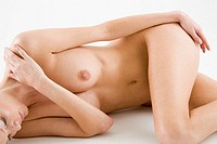 Nude woman lying down