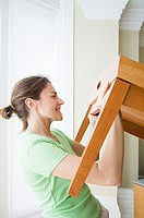 Woman moving table