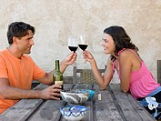 Couple toasting with wine (thumbnail)