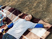 Boy lying on blanket