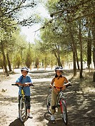 Boy and girl on bicycles