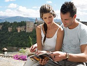 Couple looking at guidebook