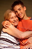 Grandmother being hugged by her grandson