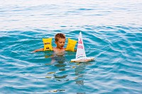 child swimming and plaing with swim arm safe