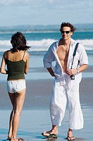 couple sightseeing on beach