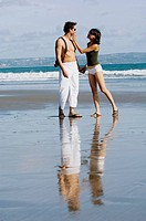 couple sightseeeing on beach