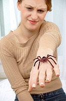 Arachnophopia treatment  Woman with an imitation spider on her hand  This treatment, known as systematic desensitization, is a form of cognitive behav...