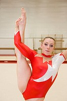 Gymnast performing a Y scale position  In gymnastics the floor is considered to be a piece of apparatus, which is a specially prepared exercise surfac...