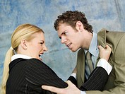 Businessman and businesswoman quarrelling (thumbnail)