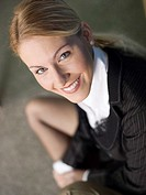 Businesswoman smiling, elevated view, portrait, close-up