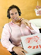 Young man having pizza for lunch