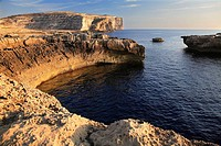 Sunset at the cliffs of Dwerja, on the island of Gozo, Malta